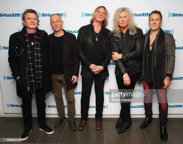 Musicians Rick Allen Phil Collen Joe Elliot Rick Savage and Vivian Campbell of Def Leppard visits the SiriusXM Studios on March 27 2019 in New York...