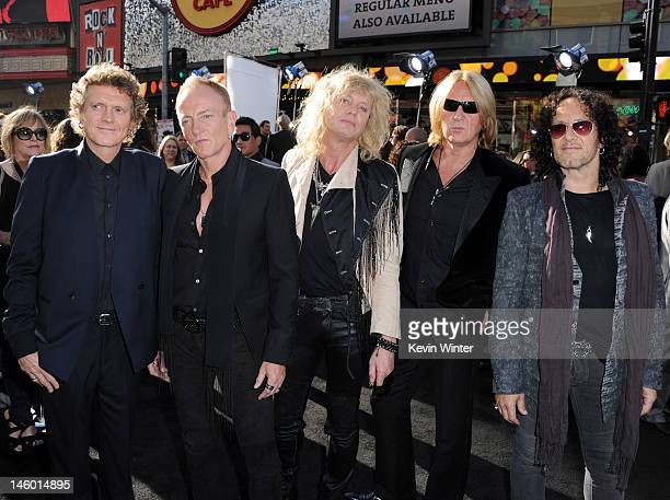 Musicians Rick Allen, Phill Collen, Rick Savage, Joe Elliott and Vivian Campbell of Def Leppard arrive at the premiere of Warner Bros. Pictures'...