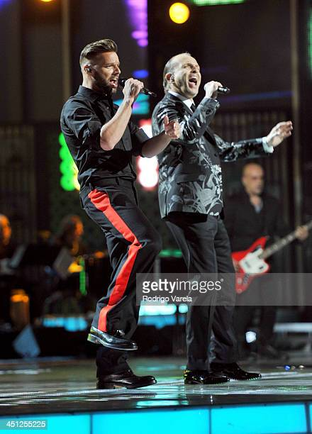 Musicians Ricky Martin and Miguel Bose performs onstage during The 14th Annual Latin GRAMMY Awards at the Mandalay Bay Events Center on November 21...