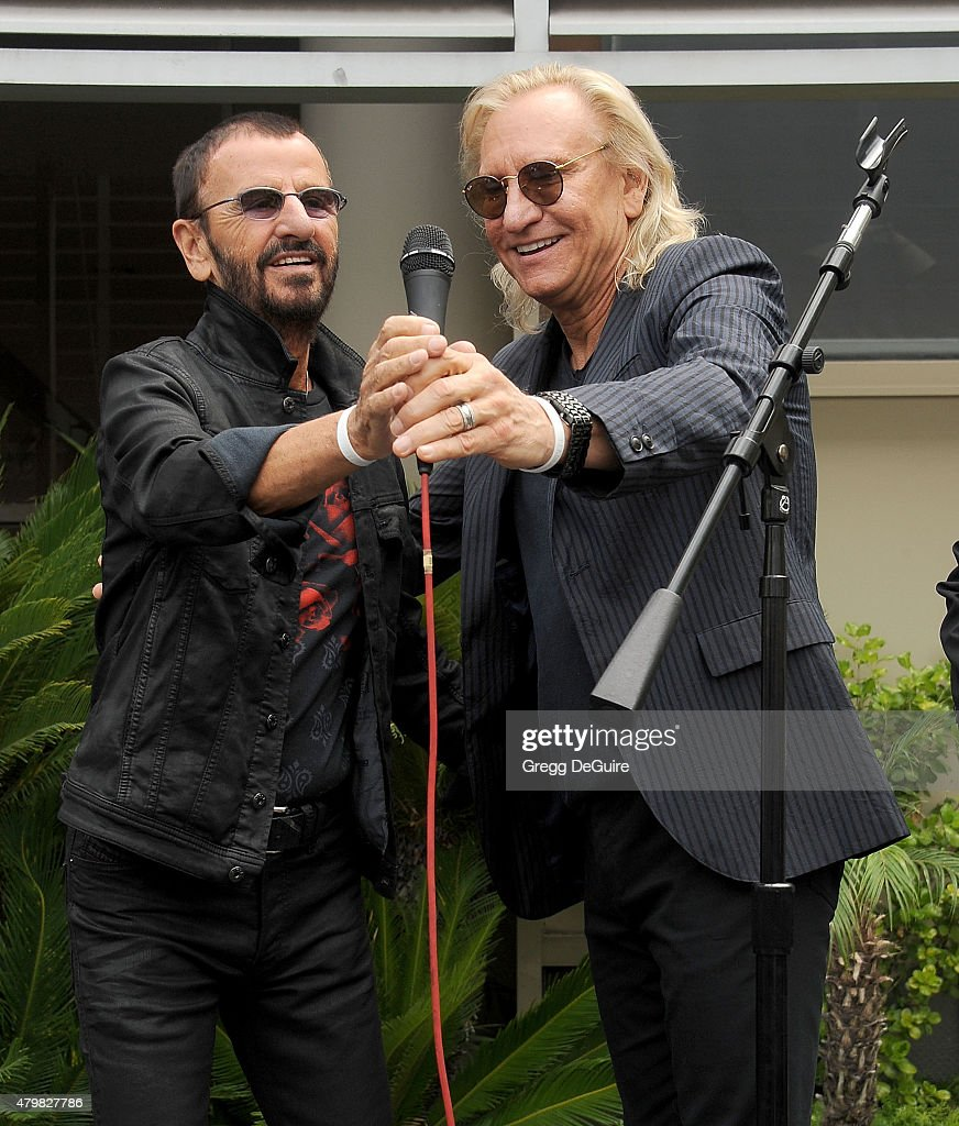 Musicians Ringo Starr and Joe Walsh attend Ringo's birthday fan gathering at Capitol Records on July 7, 2015 in Hollywood, California.