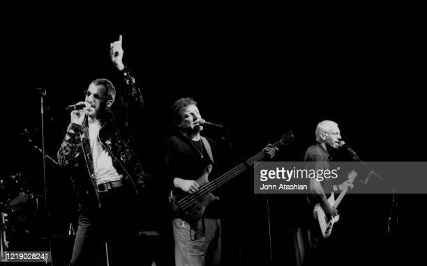 """Musicians Ringo Starr, Jack Bruce and Peter Frampton are shown performing on stage during a """"live"""" concert appearance with Ringo Starr & His All..."""