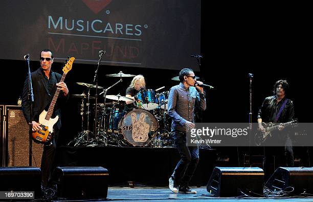 Musicians Robert DeLeo Eric Kretz Chester Bennington and Dean DeLeo perform as Stone Temple Pilots at the 9th Annual MusiCares MAP Fund Benefit...