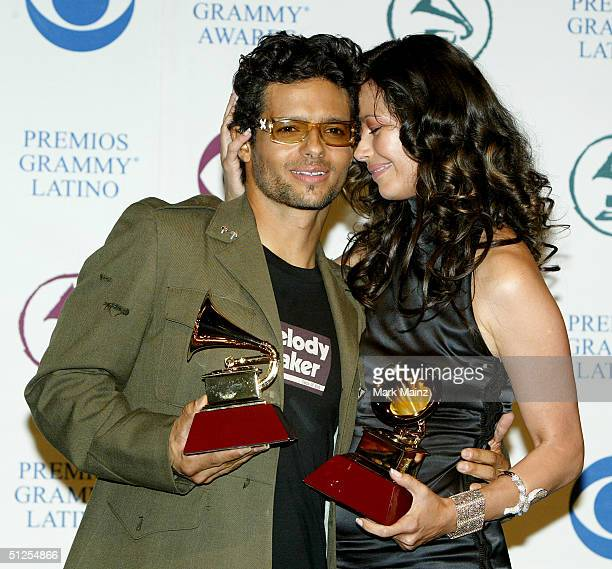 Musicians Robi Draco Rosa and Angela Alvarado Rosa winners of Best Music Video for Mas Y Mas poses backstage at the 5th Annual Latin Grammy Awards...