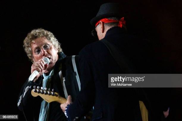 Musicians Roger Daltrey and Pete Townshend of The Who perform at halftime of Super Bowl XLIV between the Indianapolis Colts and the New Orleans...