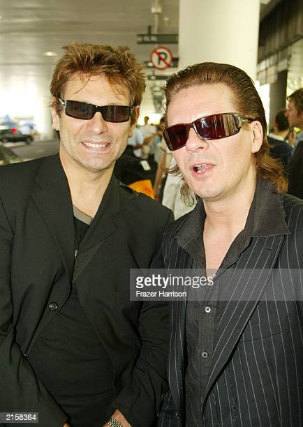 Musicians Roger Taylor and Andy Taylor of Duran Duran at Los Angeles International airport after arriving from Japan on July 13 2003 in Los Angeles...