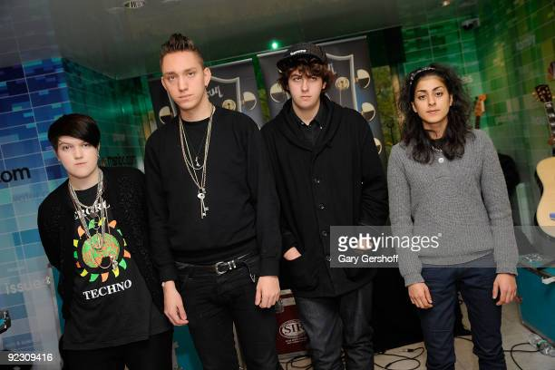Musicians Romy Madley Croft Oliver Sim Jamie Smith and Baria Qureshi of the band TheXX pose for pictures after performing at the NBC Experience Store...