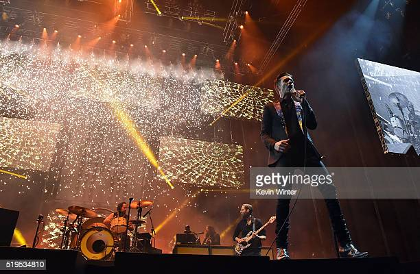 Musicians Ronnie Vannucci Jr Mark Stoermer and Brandon Flowers of The Killers perform onstage during the grand opening of TMobile Arena on April 6...