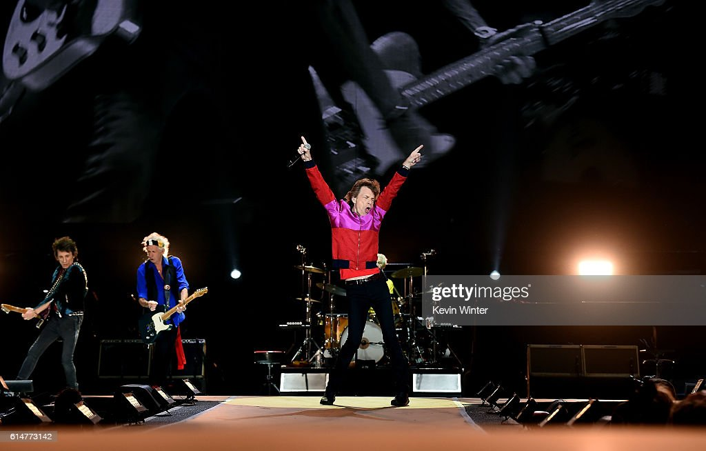 Musicians Ronnie Wood, Keith Richards and singer Mick Jagger of The Rolling Stones perform during Desert Trip at the Empire Polo Field on October 14, 2016 in Indio, California.