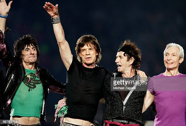 Musicians Ronnie Wood Mick Jagger Keith Richards and Charlie Watts of The Rolling Stones perform during the Sprint Super Bowl XL Halftime Show at...
