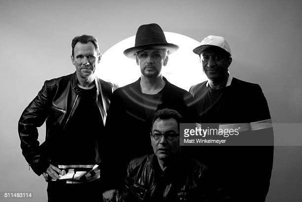 Musicians Roy Hay Boy George Jon Moss and Mikey Craig of Culture Club pose backstage during the first ever iHeart80s Party at The Forum on February...