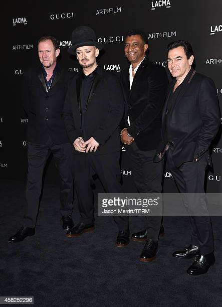 Musicians Roy Hay Boy George wearing Gucci Mikey Craig and Jon Moss of Culture Club attend the 2014 LACMA Art Film Gala honoring Barbara Kruger and...