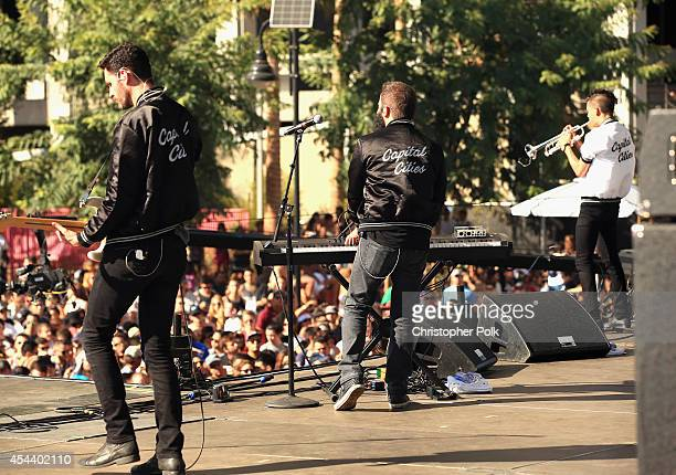 Musicians Ryan Merchant Sebu Simonian and Spencer Ludwig of Capital Cities perform on the Marilyn Stage during day 1 of the 2014 Budweiser Made in...