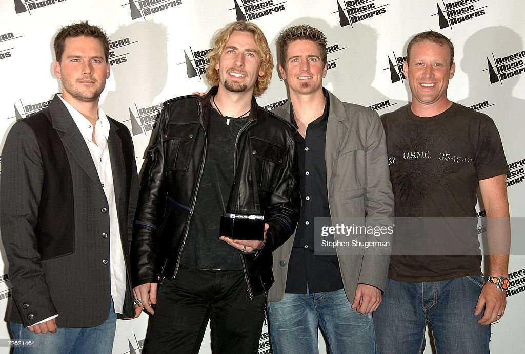Musicians Ryan Peake, Chad Kroeger, Daniel Adair and Mike Kroeger of the band Nickelback pose in the press room at the 2006 American Music Awards held at the Shrine Auditorium on November 21, 2006 in Los Angeles, California. Nickelback was honored with the 'Pop/Rock Favorite Album' award for the album 'All the Right Reasons'.