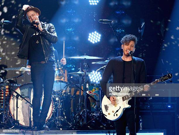 Musicians Ryan Tedder and Brent Kutzle of OneRepublic perform onstage during 1035 KISS FM's Jingle Ball 2014 at Allstate Arena on December 18 2014 in...