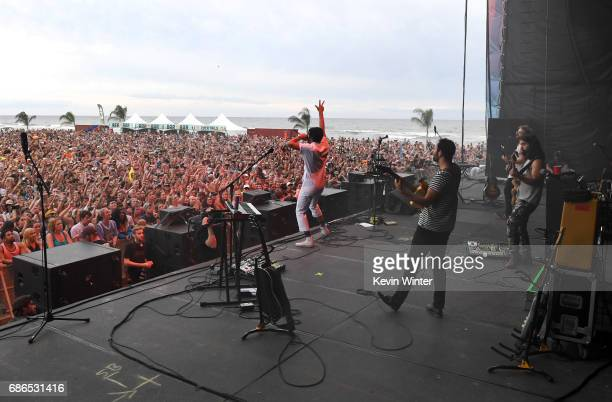 Musicians Sameer Gadhia Eric Cannata Jacob Tilley and Payam Doostzadeh of the band Young the Giant perform at the Hangout Stage during 2017 Hangout...