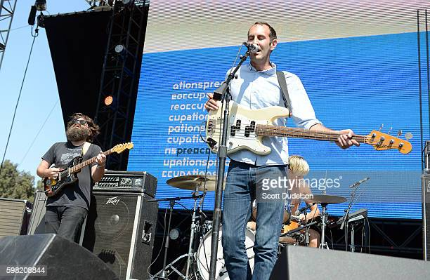 Musicians Scott Munro Mike Wallace Matt Flegel and Daniel Christiansen of the band Preoccupations perform onstage during the FYF Festival at Los...