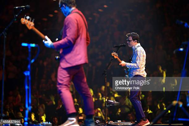 Musicians Scott Shriner and Rivers Cuomo of Weezer perform onstage during the 2014 iHeartRadio Music Festival at the MGM Grand Garden Arena on...
