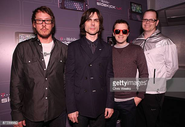 Musicians Scott Shriner Brian Bell Rivers Cuomo and Patrick Wilson of Weezer pose backstage at the TMobile Sidekick LX launch event at Paramount...