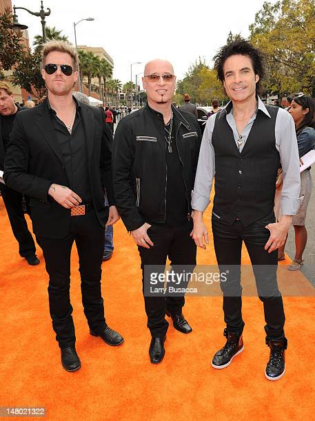 Musicians Scott Underwood Jimmy Stafford and Patrick Monahan of the band Train arrive at Nickelodeon's 24th Annual Kids' Choice Awards at Galen...