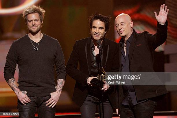 Musicians Scott Underwood Patrick Monahan and Jimmy Stafford of the band Train accept the Best Pop Performance By A Duo Or Group With Vocals Award...