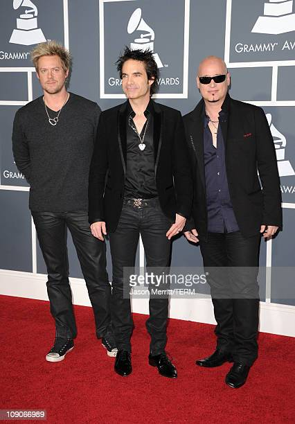 Musicians Scott Underwood Patrick Monahan and Jimmy Stafford of the band Train arrive at The 53rd Annual GRAMMY Awards held at Staples Center on...