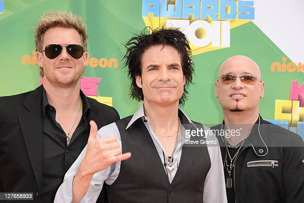 Musicians Scott Underwood Patrick Monahan and Jimmy Stafford of Train arrive at Nickelodeon's 24th Annual Kids' Choice Awards at Galen Center on...