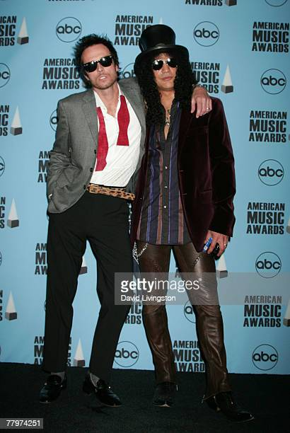 Musicians Scott Weiland and Slash pose in the press room at the 2007 American Music Awards held at the Nokia Theatre LA LIVE on November 18 2007 in...