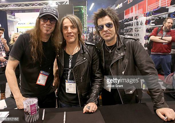 """Musicians Scotti Hill, Rob Hammersmith and Rachel Bolan of """"Skid Row"""" attend the 2017 NAMM Show at the Anaheim Convention Center on January 21, 2017..."""