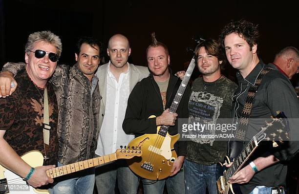 PRICING*** Musicians Scotty Wray Ron D'Argenio Jerry Flowers Aden Bubeck Keith Zebroski and Alex Weeden pose backstage during the Academy Of Country...