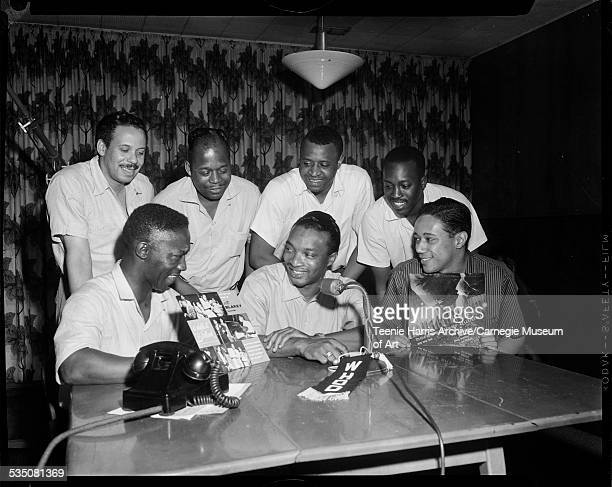 Art Blakey Walt Harper and Horace Silver standing Jon Morris Skeets Talbot Earl Mays and Hank Mobley on Walt Harper's radio show at WHOD radio...