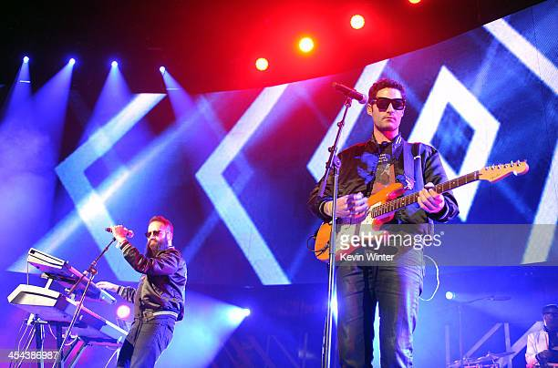 Musicians Sebu Simonian and Ryan Merchant of Capital Cities perform onstage during The 24th Annual KROQ Almost Acoustic Christmas at The Shrine...