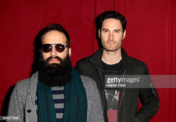 Musicians Sebu Simonian and Ryan Merchant of Capital Cities pose backstage during The 24th Annual KROQ Almost Acoustic Christmas at The Shrine...