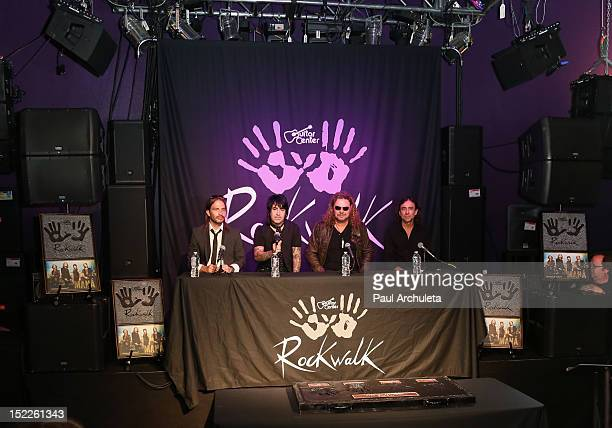 Musicians Sergio Vallin Alex Gonzalez Fher Olvera and Juan Calleros of the rock band Mana get inducted into Guitar Center's RockWalk at Guitar Center...
