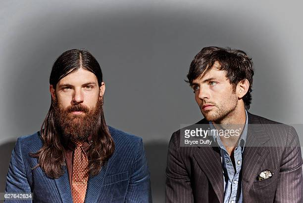 Musicians Seth and Scott Avett of The Avett Brothers are photographed for Rolling Stone Magazine on October 8 2013 in Los Angeles California...