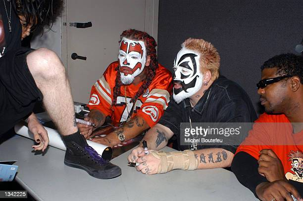 Musicians Shaggy 2 Dope Violent J and Esham from the group Insane Clown Posse sign an autograph for a fan at the Los Angeles Comic Book and Science...