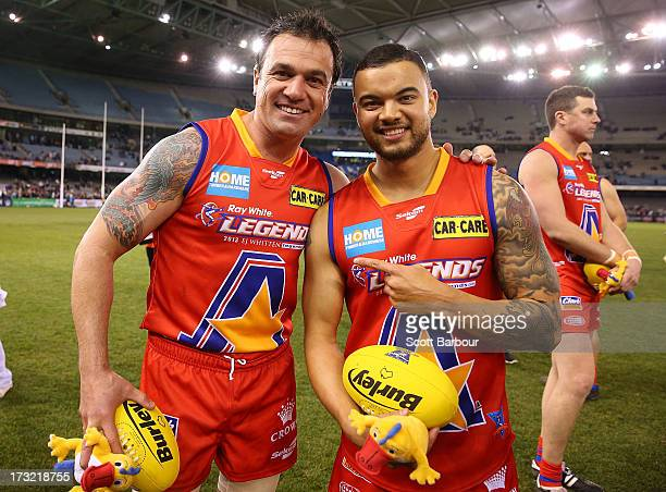 Musicians Shannon Noll and Guy Sebastian of the All Stars pose after the EJ Whitten Legends AFL game between Victoria and the All Stars at Etihad...