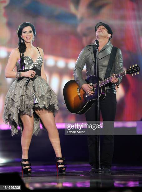 Musicians Shawna Thompson and Keifer Thompson of the band Thompson Square perform onstage at the American Country Awards 2011 at the MGM Grand Garden...