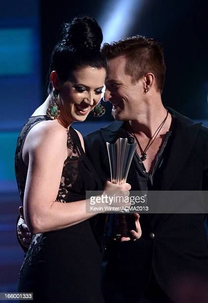 Musicians Shawna Thompson and Keifer Thompson of Thompson Square accept the Vocal Duo of the Year award onstage during the 48th Annual Academy of...