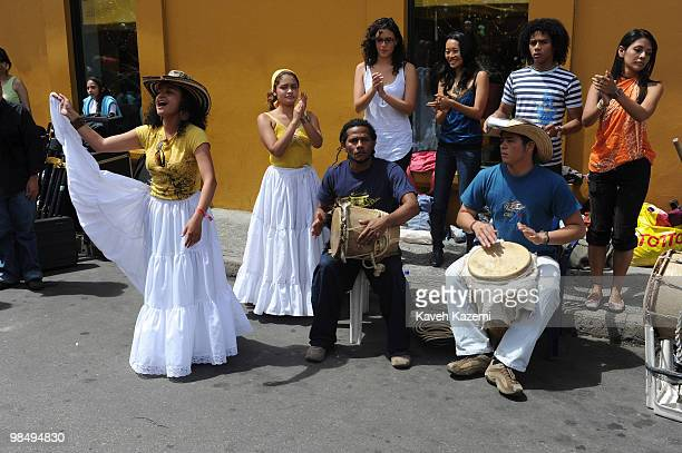 Musicians sing and dance on busy street market in the city Bogota formerly called Santa Fe de Bogota is the capital city of Colombia as well as the...