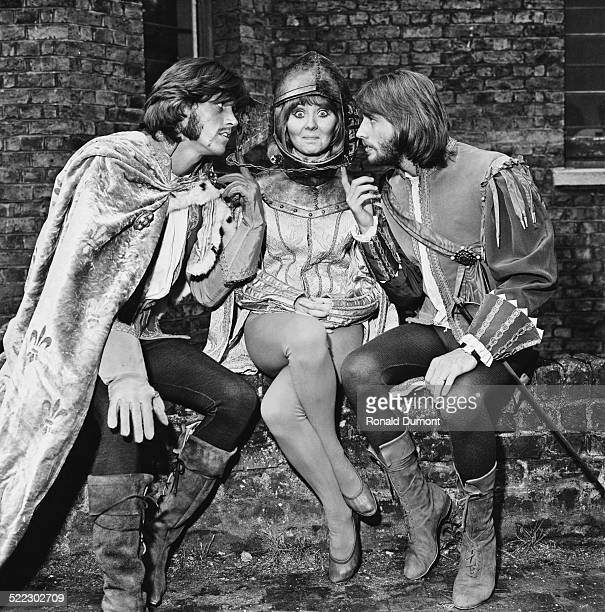 Musicians, singers, and songwriters Barry Gibb and Maurice Gibb with their co-star, Scottish singer Lulu, during production of the comedy film...