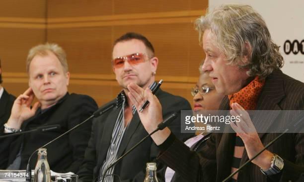 Musicians Sir Bob Geldof former Nigerian Finance Minister Ngozi OkonjoIweala Bono and Herbert Groenemeyer present the DATA report 2007 during a news...
