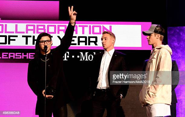 Musicians Skrillex Diplo and Justin Bieber winners of the Collaboration of the Year award onstage during the 2015 American Music Awards at Microsoft...