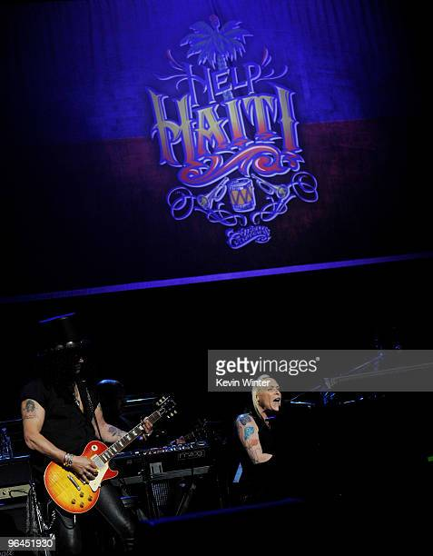Musicians Slash and Beth Hart perform onstage at Help Haiti with George Lopez Friends at LA Live's Nokia Theater on February 4 2010 in Los Angeles...