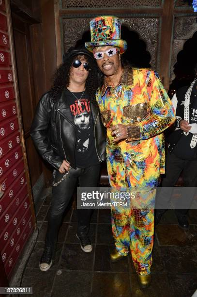 Musicians Slash and Bootsy Collins attend the BandFuse Rock Legends video game launch event at House of Blues Sunset Strip on November 12 2013 in...