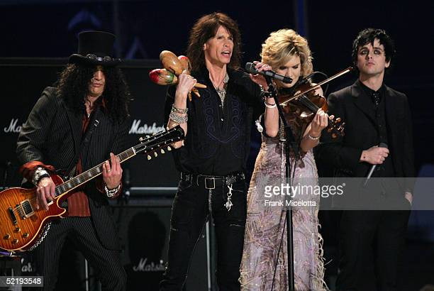 Musicians Slash Steven Tyler Allison Krauss and Billie Joe Armstrong perform Across The Universe in the tsunami relief peformance on stage during the...