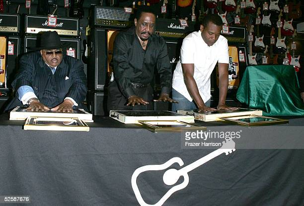 Musicians Solomon Burke, Ike Turner and Robert Cray press their pamls into cement as they are inducted into the Hollywood Rockwalk along with Etta...