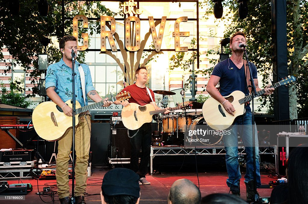 Musicians Stephen Barker Liles (L) and Eric Gunderson (R) of Love And Theft perform at The 2013 Summer Concert Series at The Grove on July 17, 2013 in Los Angeles, California.