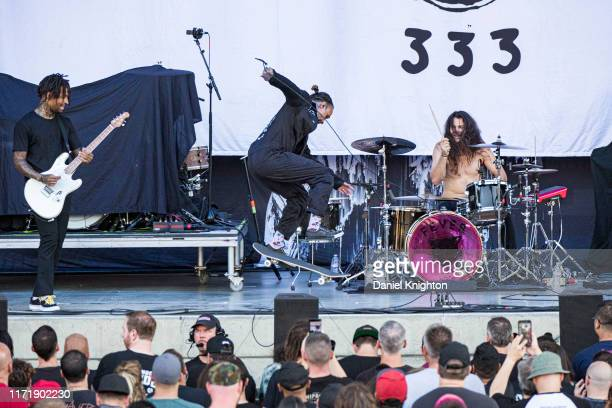 Musicians Stephen Harrison Jason Aalon Butler and Aric Improta of Fever 333 perform on stage at North Island Union Amphitheatre on September 02 2019...