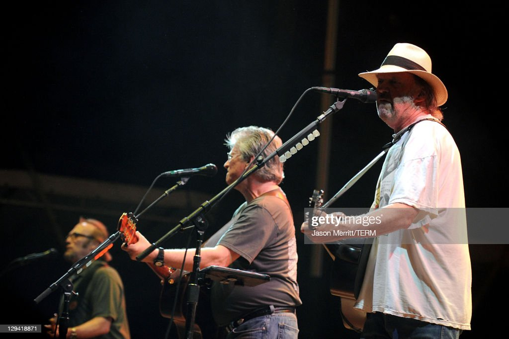 Musicians Stephen Stills, Richie Furay and Neil Young of Buffalo Springfield perform on stage during Bonnaroo 2011 at Which Stage on June 11, 2011 in Manchester, Tennessee.