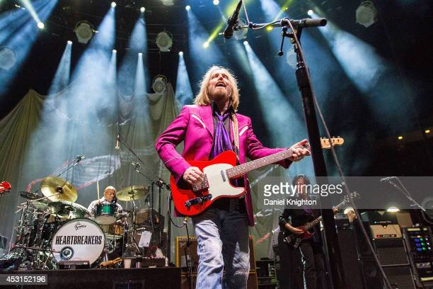 Musicians Steve Ferrone Tom Petty and Ron Blair perform on stage with Tom Petty The Heartbreakers at Viejas Arena on August 3 2014 in San Diego...